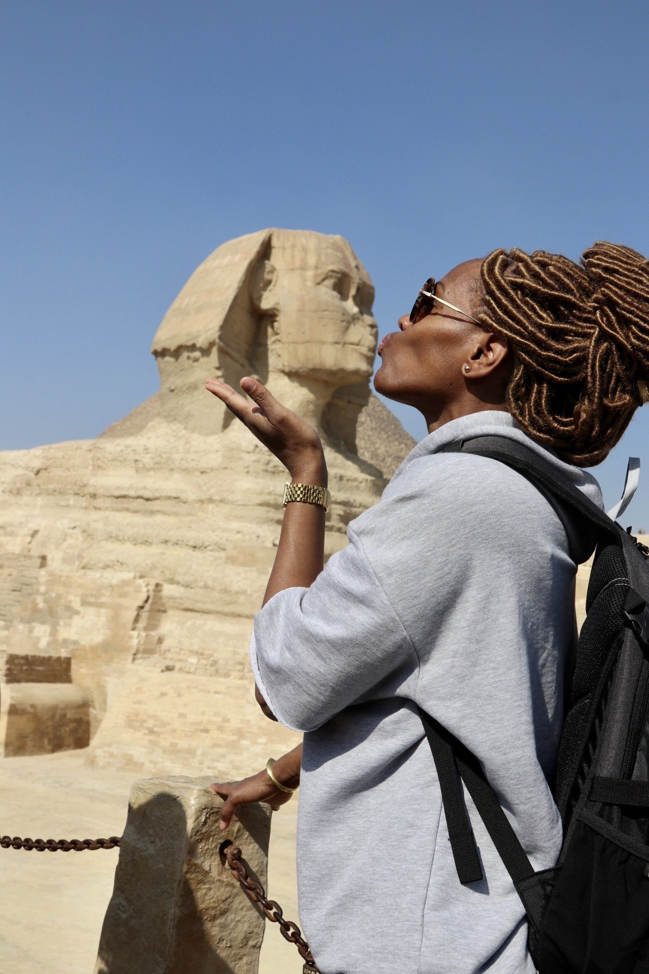 woman kissing the Great Sphinx pyramid in Egypt