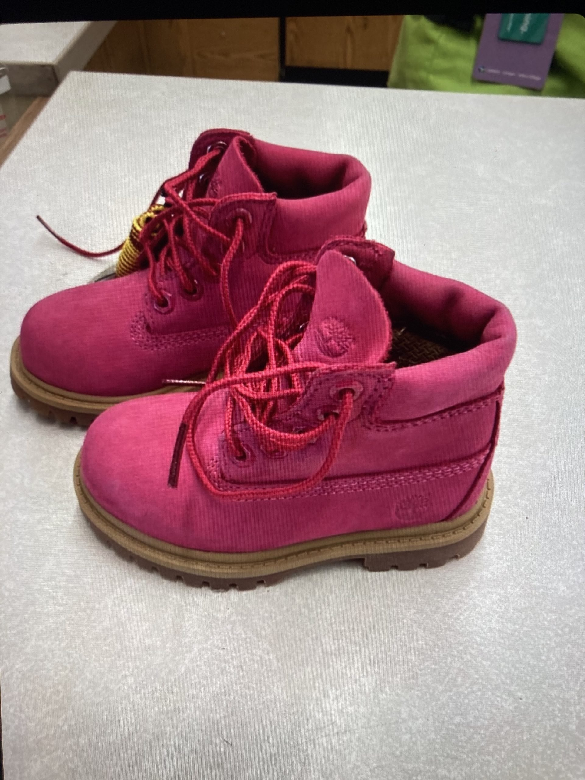pink Timberland boots from Unique Thrift Store