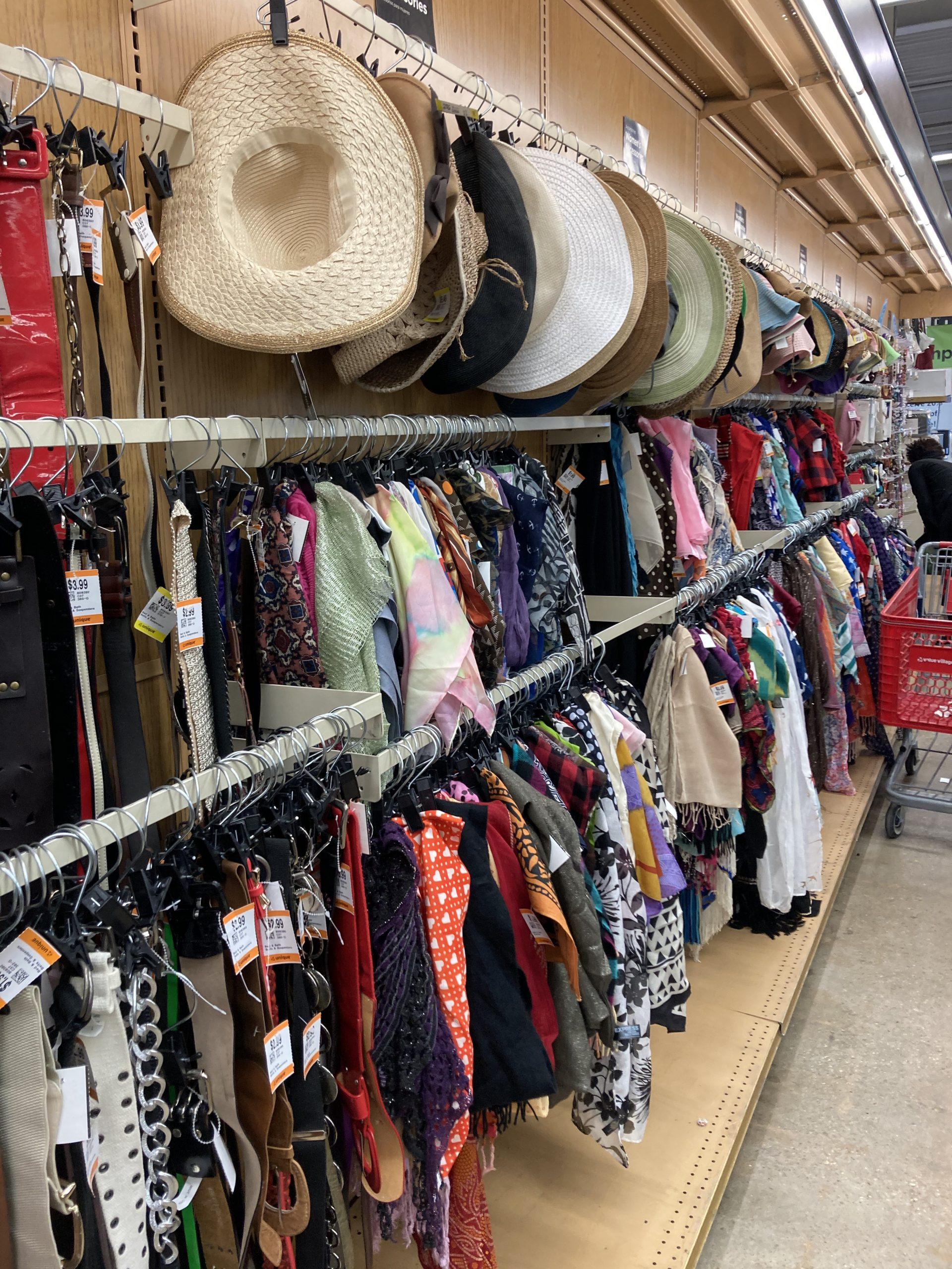 wall rack of clothing in Unique Thrift Store