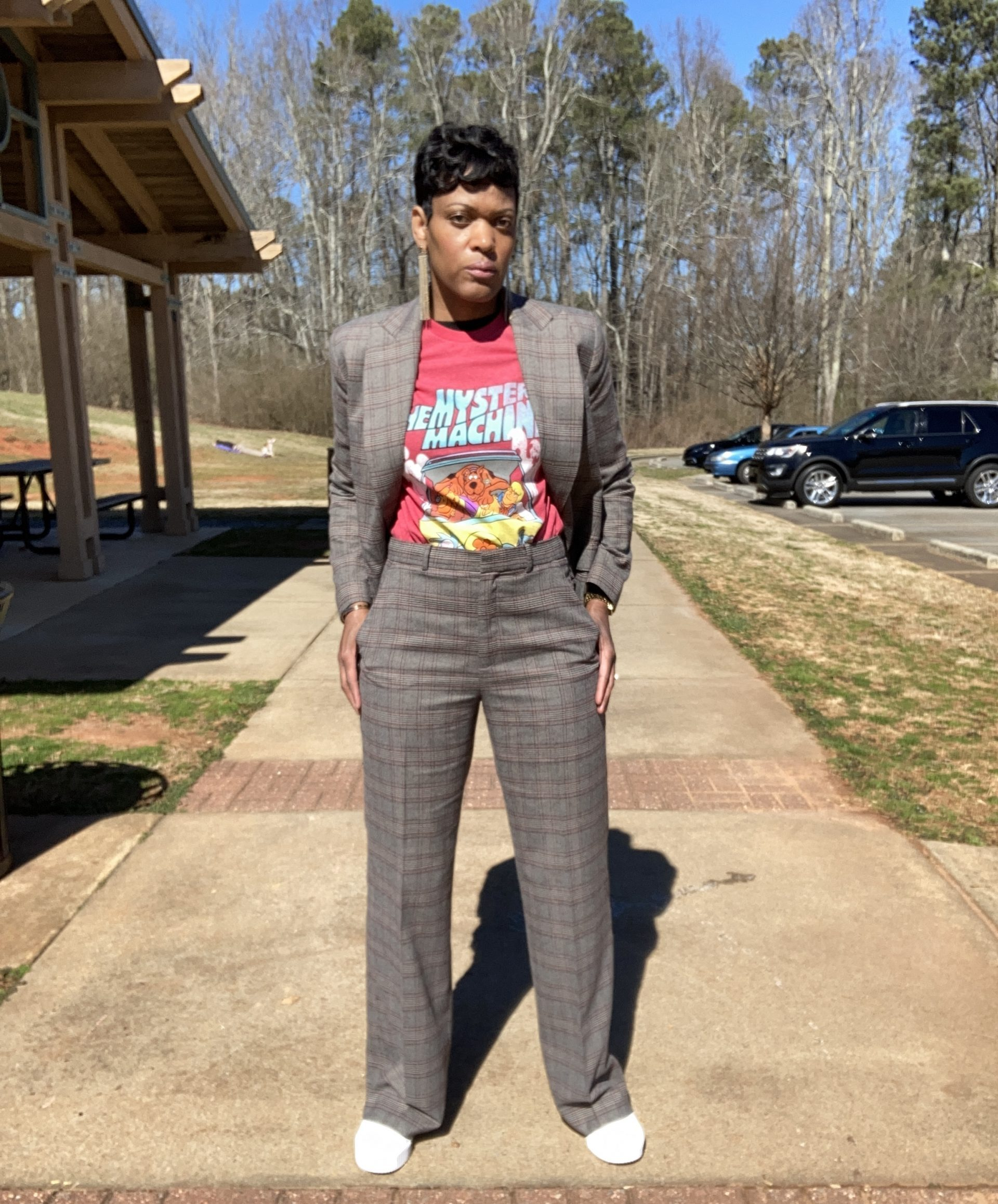plaid suit styled with a graphic tee